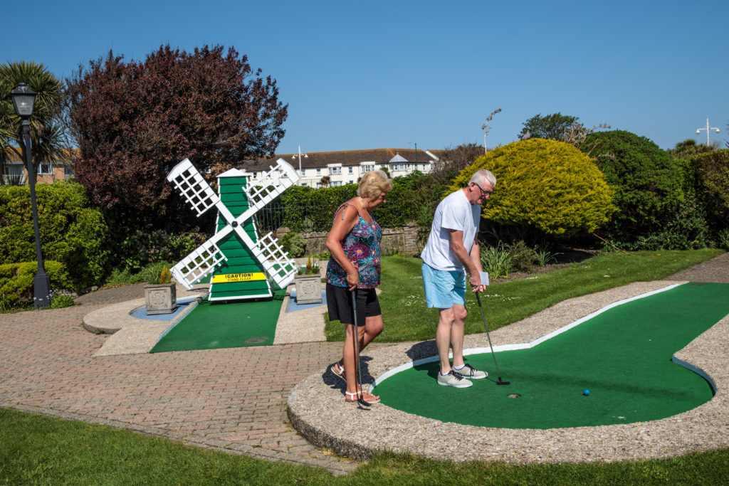 A couple play a game of crazy golf